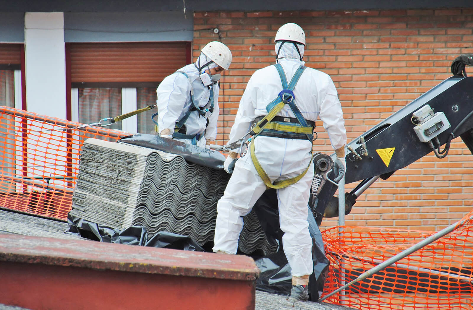 Packing Asbestos onto Crate
